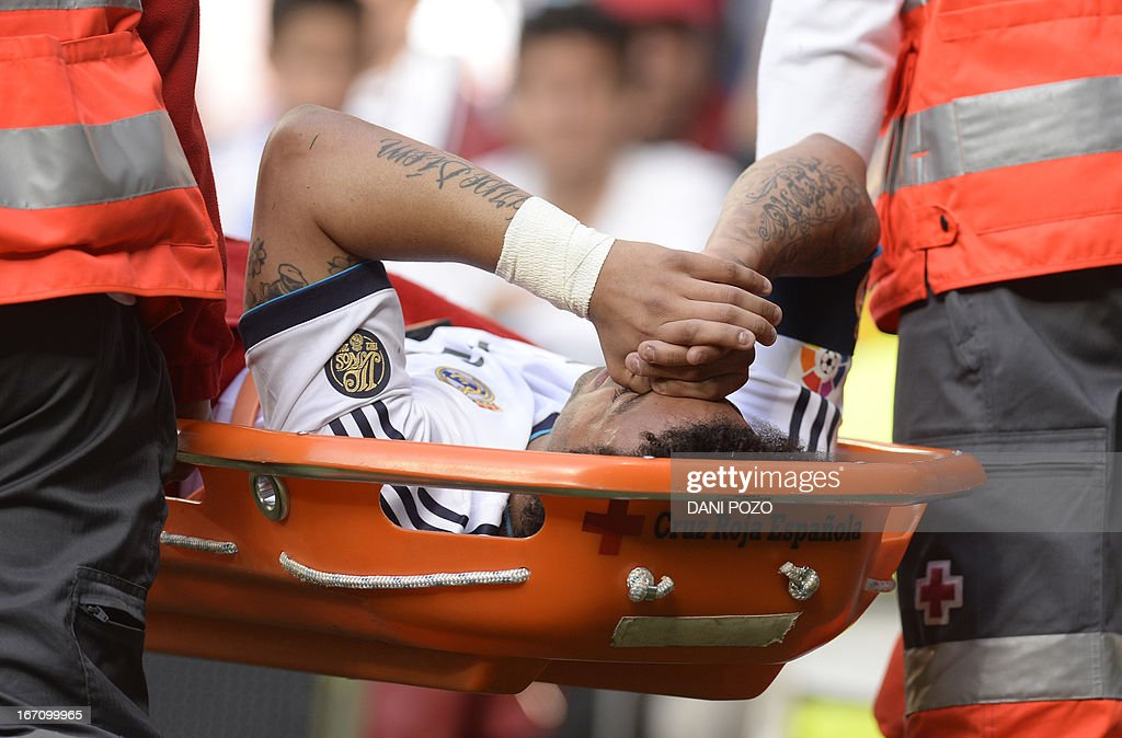 Real Madrid's Brazilian defender Marcelo leaves the pitch on a stretcher during the Spanish league football match Real Madrid CF vs Real Betis at the Santiago Bernabeu stadium in Madrid on April 20, 2013.