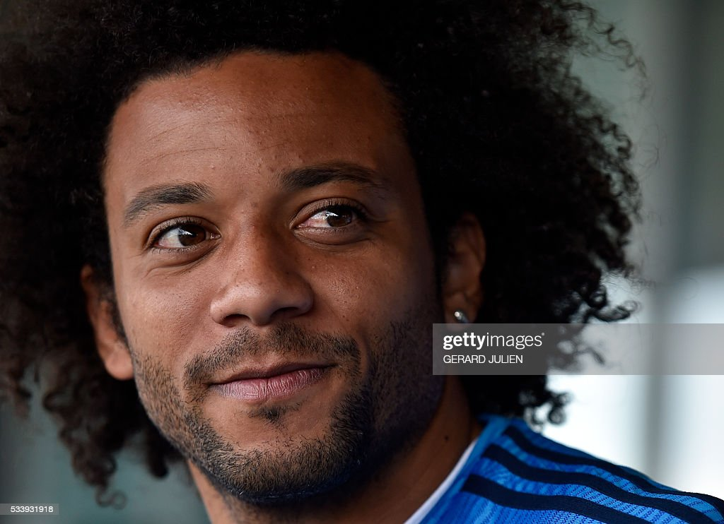 Real Madrid's Brazilian defender Marcelo looks on as he addresses journalists during the club's Open Media Day at Real Madrid sport city in Madrid on May 24, 2016. / AFP / GERARD