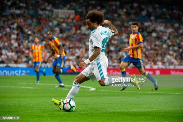 Real Madrid's Brazilian defender Marcelo prepares to kick the ball during the Spanish league football match Real Madrid CF vs Valencia CF at the...