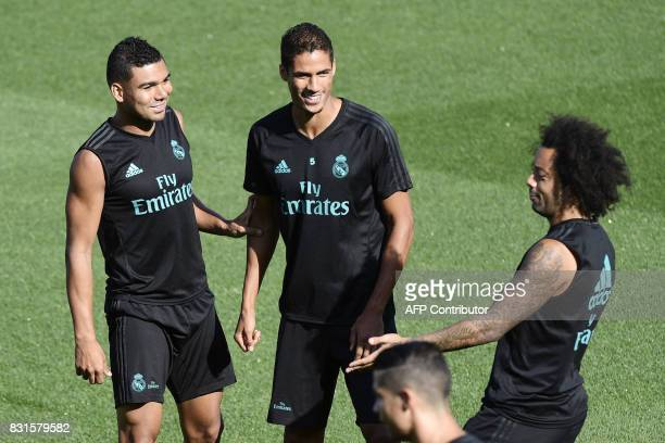 Real Madrid's Brazilian defender Marcelo Real Madrid's Brazilian midfielder Casemiro and Real Madrid's French defender Raphael Varane take part in a...