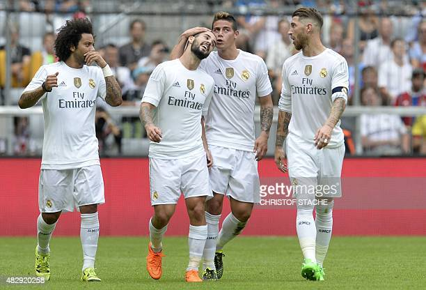 Real Madrid's Brazilian defender Marcelo Real Madrid's midfielder Isco Real Madrid's Columbian midfielder James and Real Madrid's defender Sergio...