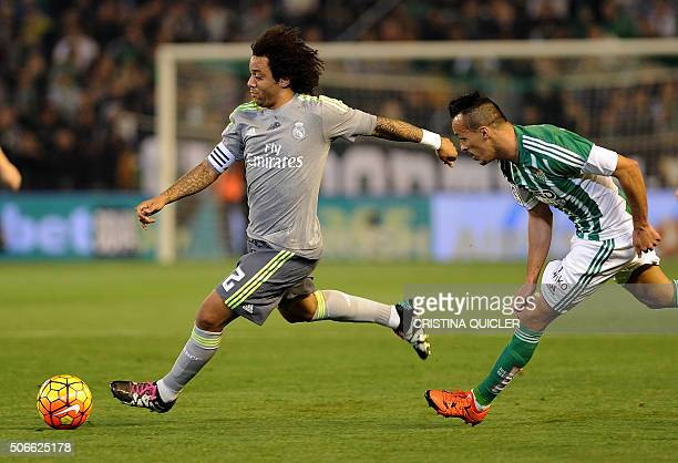Real Madrid's Brazilian defender Marcelo vies with Betis' French midfielder Kadir during the Spanish league football match Real Betis Balompie vs...