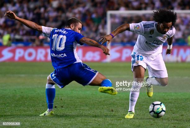 Real Madrid's Brazilian defender Marcelo vies with Deportivo La Coruna's Romanian forward Florin Andone during the Spanish league footbal match RC...