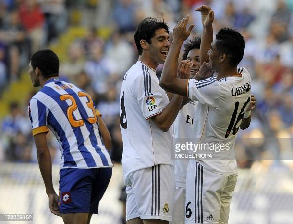 Real Madrid's Brazilian midfielder Carlos Henrique Casimiro celebrates with teammates Brazilian midfielder Kaka and Brazilian defender Marcelo after...
