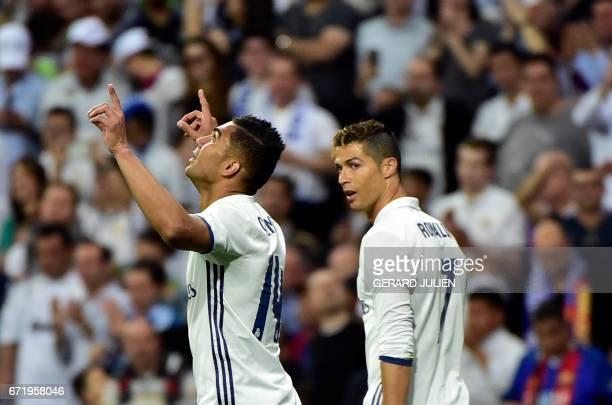 Real Madrid's Brazilian midfielder Casemiro celebrates a goal beside Real Madrid's Portuguese forward Cristiano Ronaldo during the Spanish league...