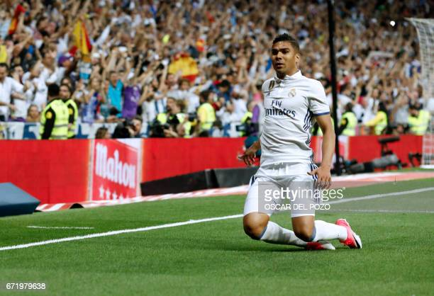 Real Madrid's Brazilian midfielder Casemiro celebrates a goal during the Spanish league football match Real Madrid CF vs FC Barcelona at the Santiago...