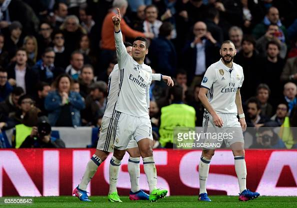 Real Madrid's Brazilian midfielder Casemiro celebrates a goal with Real Madrid's French forward Karim Benzema during the UEFA Champions League round...