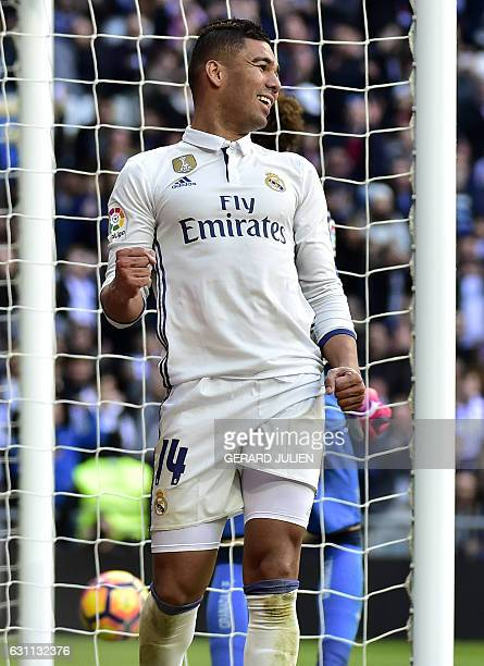 Real Madrid's Brazilian midfielder Casemiro celebrates after scoring during the Spanish league football match Real Madrid CF vs Granada FC at the...