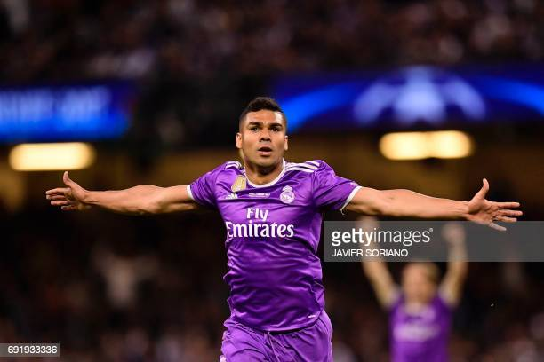 Real Madrid's Brazilian midfielder Casemiro celebrates after scoring their second goal during the UEFA Champions League final football match between...