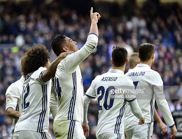 Real Madrid's Brazilian midfielder Casemiro celebrates with his teammates after scoring during the Spanish league football match Real Madrid CF vs...