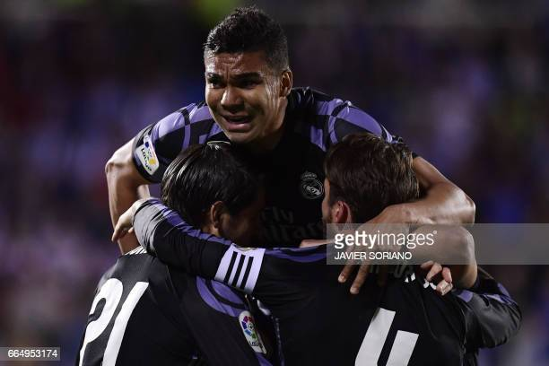 Real Madrid's Brazilian midfielder Casemiro celebrates with teammates after scoring their second goal during the Spanish league football match Club...