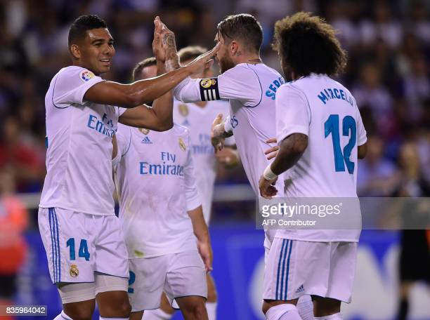 Real Madrid's Brazilian midfielder Casemiro celebrates with teammates after scoring during the Spanish league footbal match RC Deportivo de la Coruna...