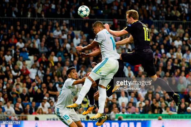 Real Madrid's Brazilian midfielder Casemiro jumps for the ball next to Tottenham Hotspur's English striker Harry Kane and Real Madrid's Moroccan...