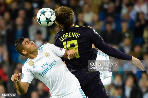 Real Madrid's Brazilian midfielder Casemiro jumps for the ball with Tottenham Hotspur's Spanish striker Fernando Llorente during the UEFA Champions...