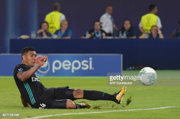 Real Madrid's Brazilian midfielder Casemiro shoots and scores during the UEFA Super Cup football match between Real Madrid and Manchester United on...