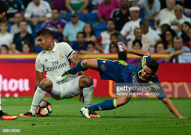 Real Madrid's Brazilian midfielder Casemiro vies with Celta Vigo's Chilean forward Fabian Orellana during the Spanish league football match Real...