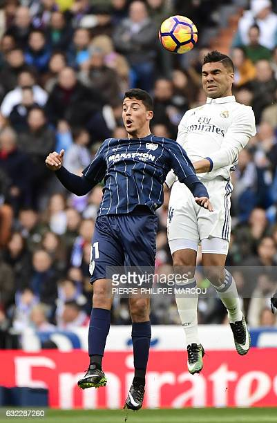 Real Madrid's Brazilian midfielder Casemiro vies with Malaga's midfielder Pablo Fornals during the Spanish league football match Real Madrid CF vs...