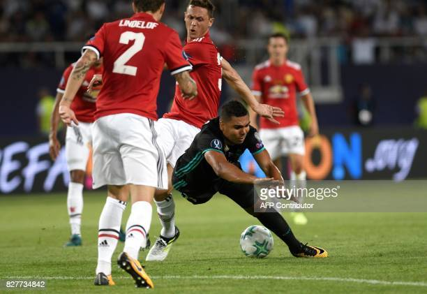 Real Madrid's Brazilian midfielder Casemiro vies with Manchester United's Serbian midfielder Nemanja Matic during the UEFA Super Cup football match...