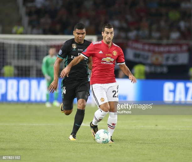 Real Madrid's Brazilian midfielder Casemiro vies with Manchester United's Armenian midfielder Henrikh Mkhitaryan during the UEFA Super Cup football...