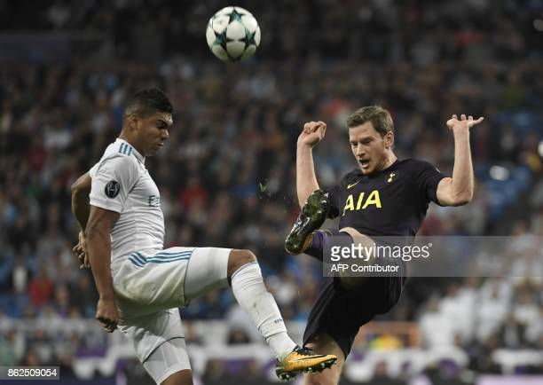 Real Madrid's Brazilian midfielder Casemiro vies with Tottenham Hotspur's Belgian defender Jan Vertonghen during the UEFA Champions League group H...