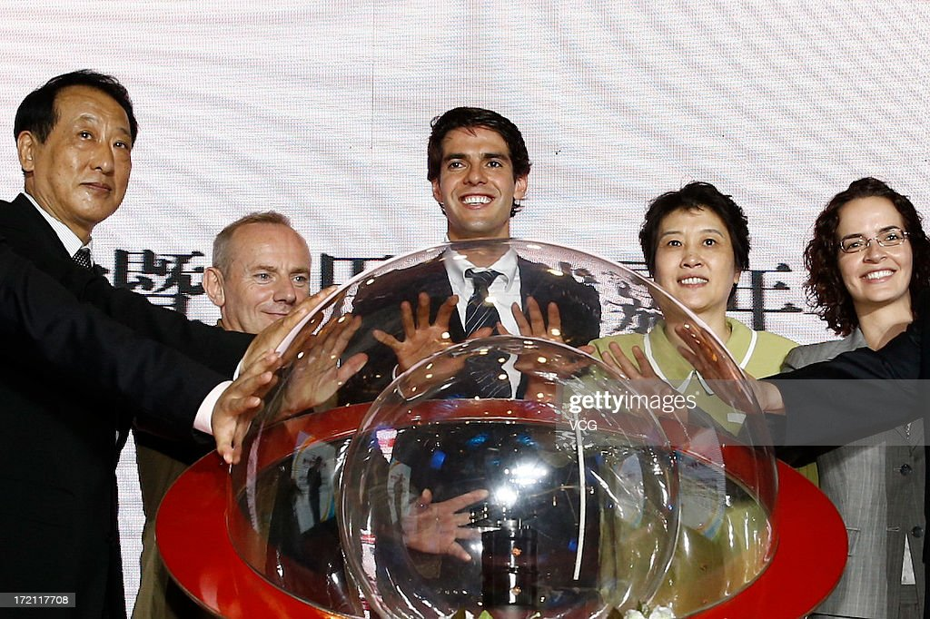 Real Madrid's Brazilian midfielder Kaka (C) attends the Grand Sino-Brazil Cultural and Sports Exchange Activities and Sino-Brazil Football Carnival launching ceremony at National Stadium on July 2, 2013 in Beijing, China.