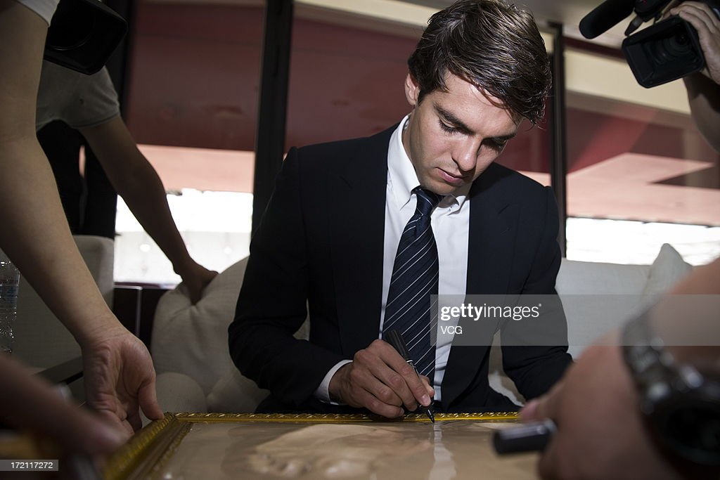 Real Madrid's Brazilian midfielder Kaka signs his footprints prior to the Grand Sino-Brazil Cultural and Sports Exchange Activities and Sino-Brazil Football Carnival launching ceremony at the National Stadium on July 2, 2013 in Beijing, China.