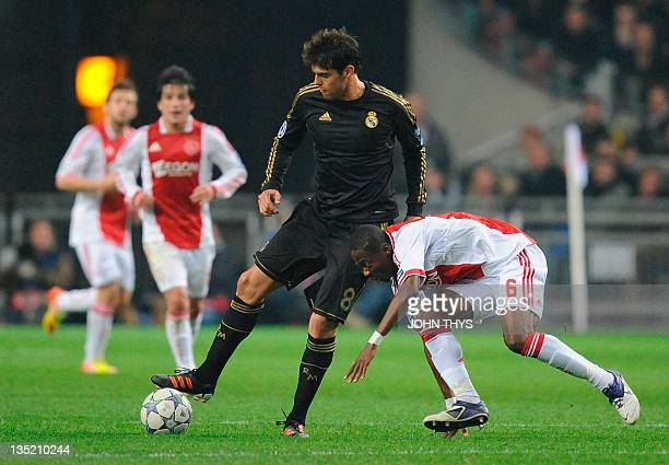 Real Madrid's Brazilian midfielder Kaka vies with Ajax Amsterdam's midfielder Eyong Enoh during the the UEFA Champions League Group E football match...