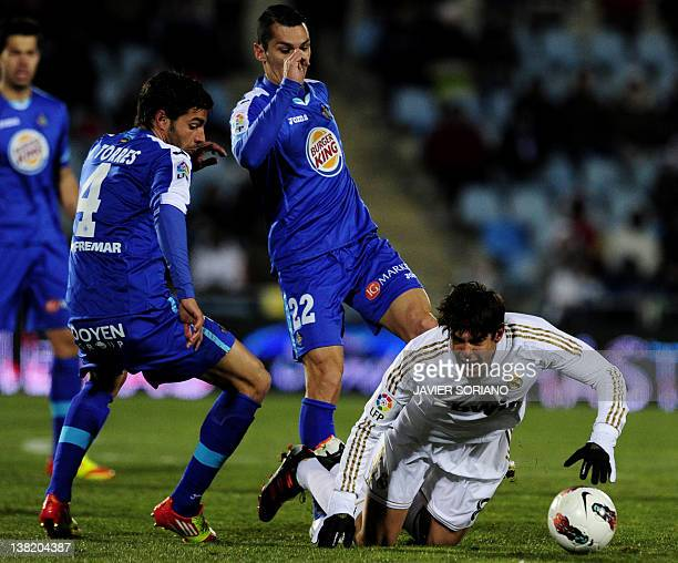 Real Madrid's Brazilian midfielder Kaka vies with Getafe's defender Miguel Torres and Getafe's midfielder Javier Casquero during their Spanish league...