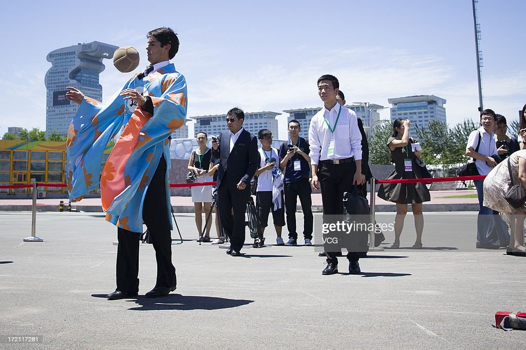 Real Madrid's Brazilian midfielder Kaka wearing ancient Chinese clothing plays Cuju, an ancient Chinese football, in front of the National Stadium on July 2, 2013 in Beijing, China.