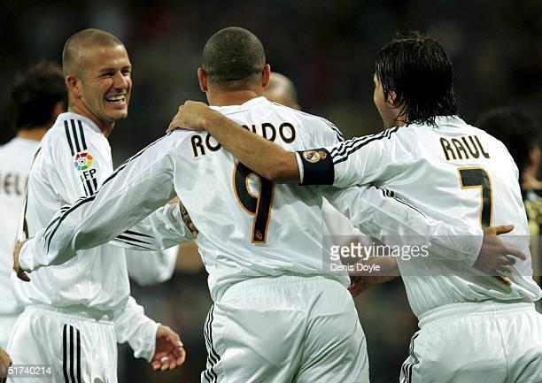Real Madrid's Brazilian player Ronaldo celebrates with Englands David Beckham left and Raul Gonzalez after scoring a goal in a Primera Liga soccer...