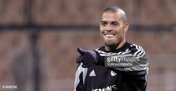 Real Madrid's Brazilian striker Ronaldo points out during a training session at Kiev's Olympic stadium 02 November 2004 on the eve of the Champions...