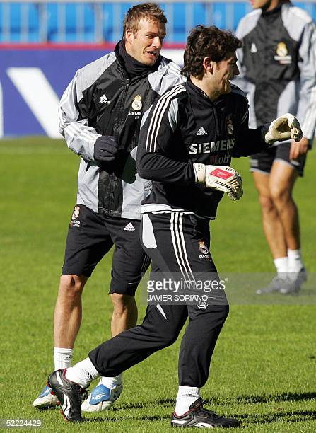 Real Madrid's Briton David Beckham jokes with his teammate Iker Casillas during a training session on the eve of their Champions League football...