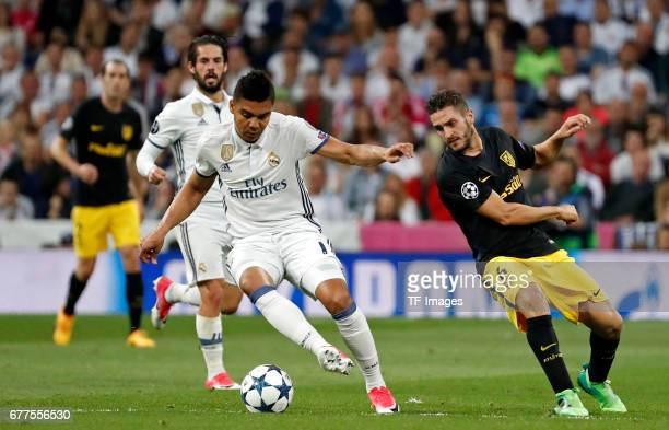 Real Madrid´s Casemiro and Atletico de Madrid´s Koke battle for the ball during the UEFA Champions League semifinal first leg match between Real...