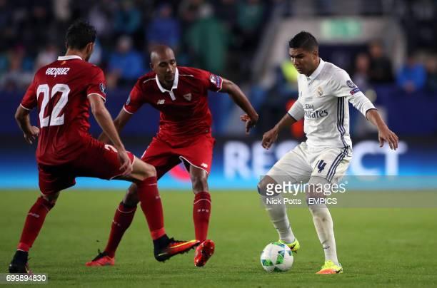Real Madrid's Casemiro and Sevilla's Franco Vazquez battle for the ball