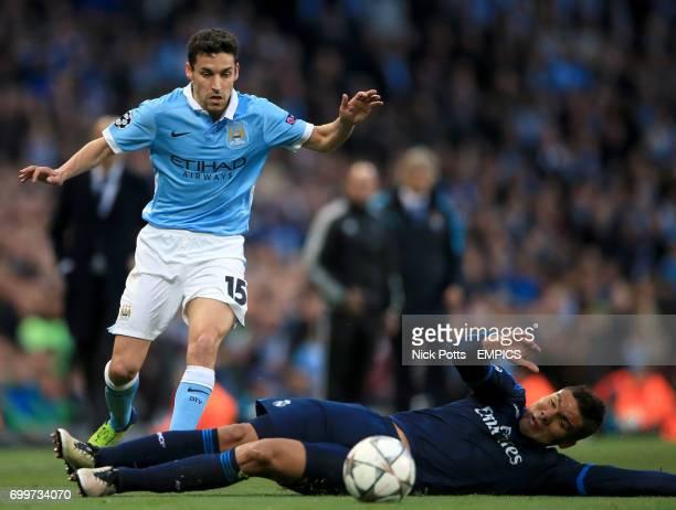 Real Madrid's Casemiro tackles Manchester City's Jesus Navas