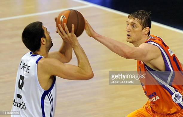 Real Madrid's center Felipe Reyes vies with Power Elec Valencia's Ukrainian forward Serhiy Lishchuk during the Euroleague basketball match Power Elec...