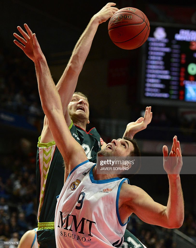 Real Madrid's centre Felipe Reyes (R) vies with Unicaja's Croatian centre Luka Zoric during the Euroleague basketball match Real Madrid vs Unicaja at the Palacio de los Deportes in Madrid on March 15, 2013.