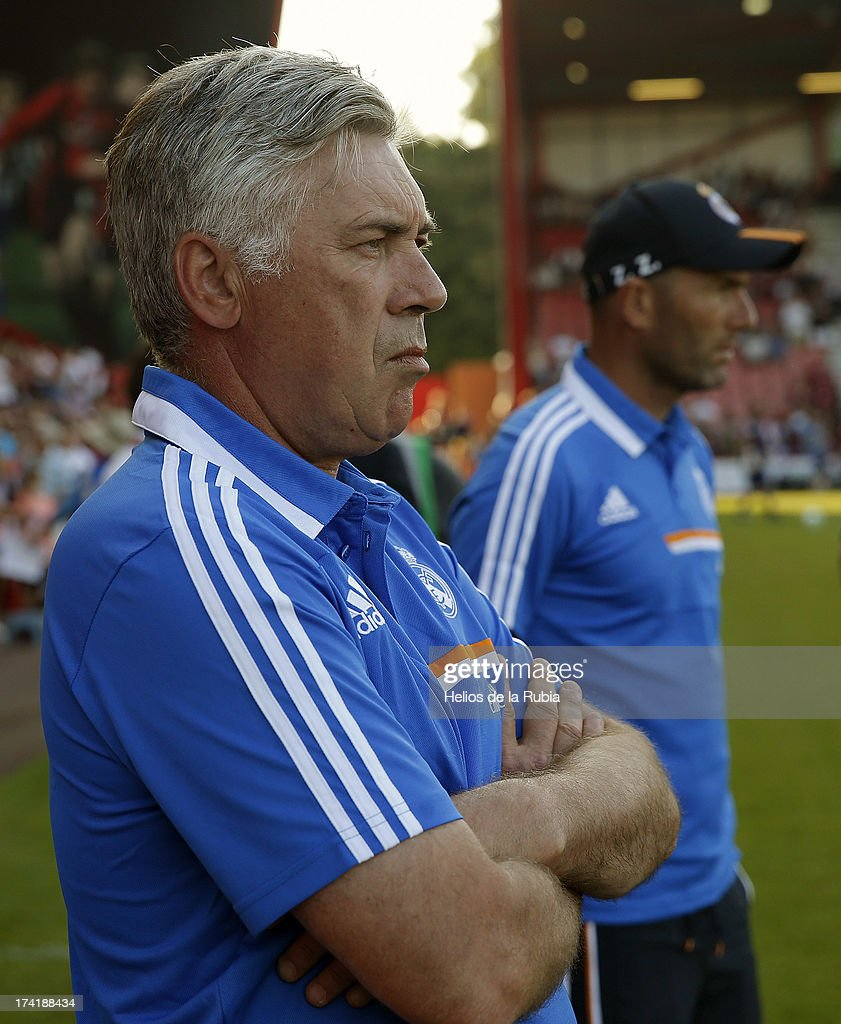 Real Madrid's coach Carlo Ancelotti (L) and assistant Zinedine Zidane look on as his team play during the pre-season friendly football match between Bournemouth and Real Madrid at the Goldsands Stadium in Bournemouth, England on July 21, 2013 at Goldsands Stadium on July 21, 2013 in Bournemouth, England.