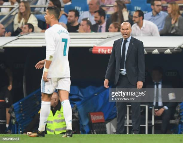 Real Madrid's coach from France Zinedine Zidane gives instructions from the sideline as Real Madrid's forward from Portugal Cristiano Ronaldo walks...