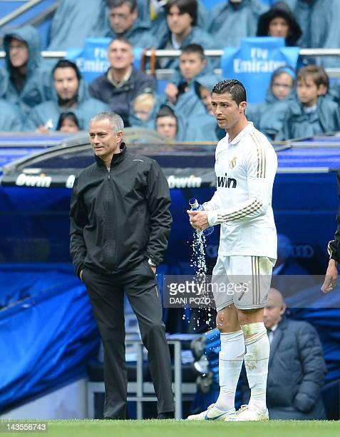 Real Madrid's coach Jose Mourinho stands next to Real Madrid's Portuguese forward Cristiano Ronaldo during the Spanish League football match Real...
