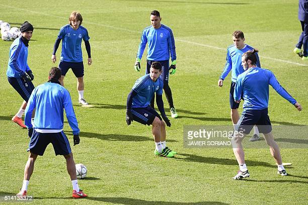 Real Madrid's Colombian midfielder James Rodriguez and teammates take part in a training session on March 7 2015 at Real Madrid Sport City in Madrid...