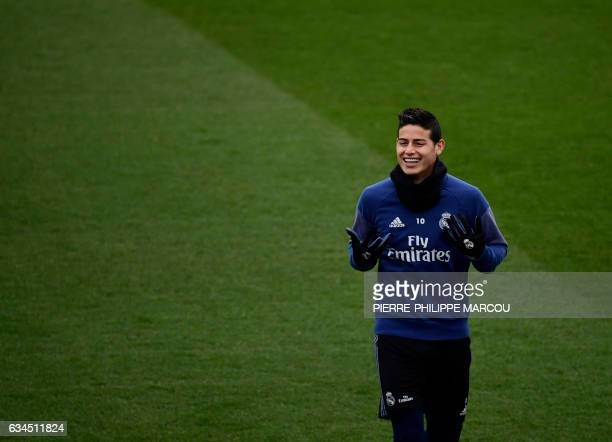 Real Madrid's Colombian midfielder James Rodriguez attends a training session at Valdebebas Sport City in Madrid on February 10 2017 on the eve of...