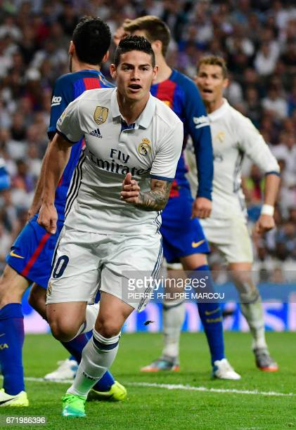 Real Madrid's Colombian midfielder James Rodriguez celebrates a goal during the Spanish league football match Real Madrid CF vs FC Barcelona at the...