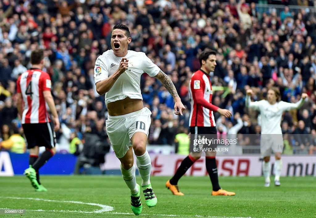 Real Madrid's Colombian midfielder James Rodriguez celebrates after scoring during the Spanish league football match Real Madrid CF vs Athletic Club Bilbao at the Santiago Bernabeu stadium in Madrid on February 13, 2016. / AFP / GERARD JULIEN