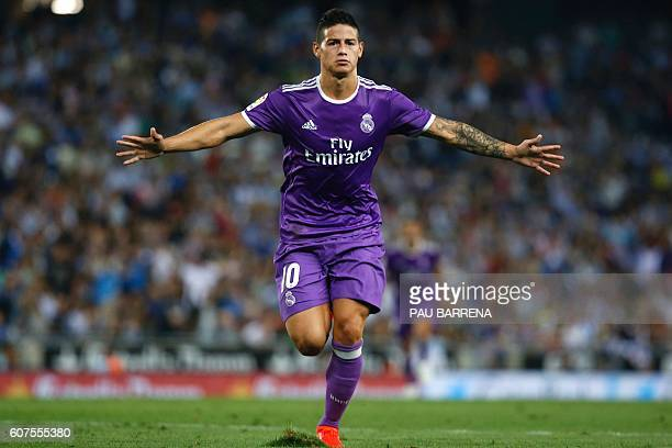 TOPSHOT Real Madrid's Colombian midfielder James Rodriguez celebrates after scoring during the Spanish league football match RCD Espanyol vs Real...