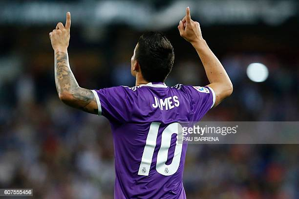 Real Madrid's Colombian midfielder James Rodriguez celebrates after scoring during the Spanish league football match RCD Espanyol vs Real Madrid CF...