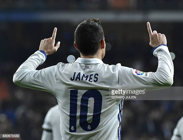 TOPSHOT Real Madrid's Colombian midfielder James Rodriguez celebrates after scoring on a penalty kick during the Spanish Copa del Rey round of 16...