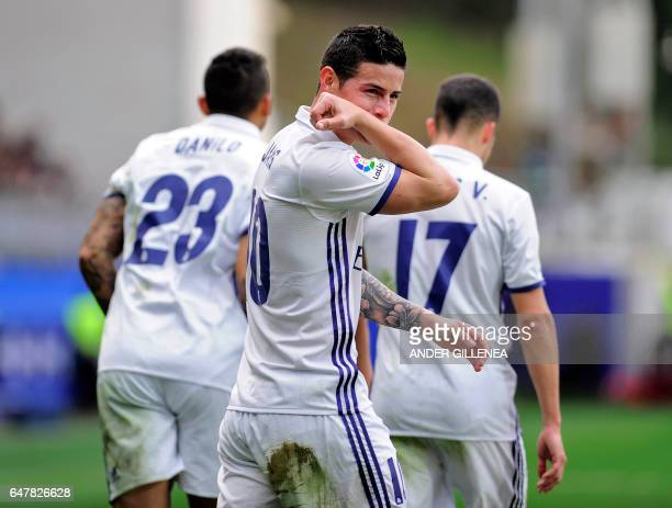 TOPSHOT Real Madrid's Colombian midfielder James Rodriguez celebrates after scoring their team's third goal during the Spanish league football match...