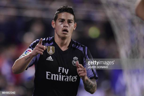 Real Madrid's Colombian midfielder James Rodriguez celebrates after scoring during the Spanish league football match Club Deportivo Leganes SAD vs...