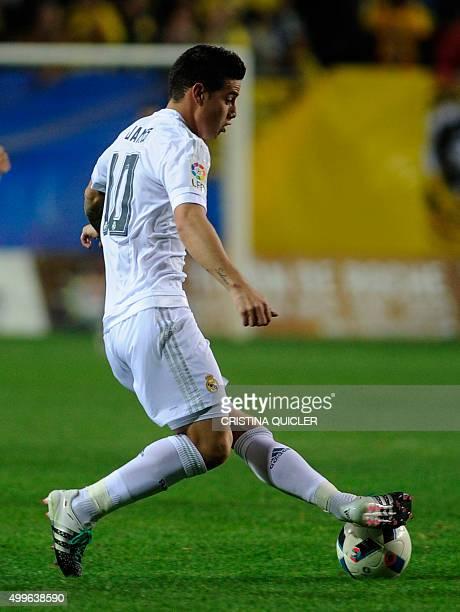 Real Madrid's Colombian midfielder James Rodriguez kicks the ball during the Spanish Copa del Rey football match Cadiz CF vs Real Madrid at the Ramon...
